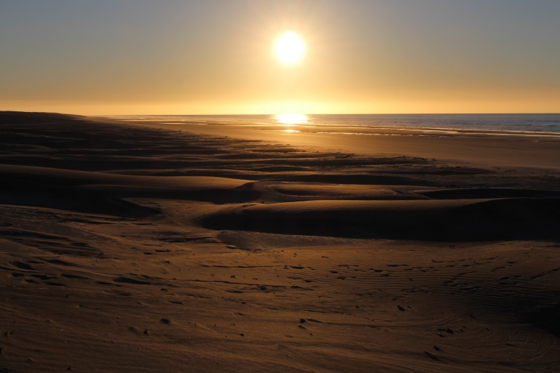 The sun setting on the dunes